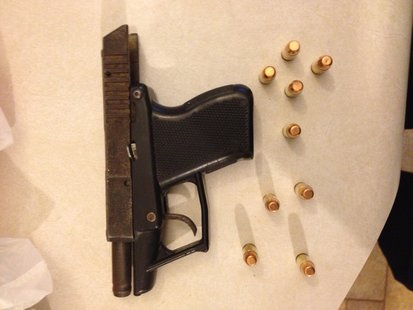 A handgun was seized after a search of the location.
